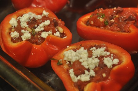 Red Peppers stuffed with tomatoes, olives, and pine nuts